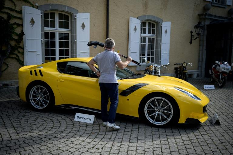 This 2015 Ferrari F12tdf Berlinetta was among those auctioned off Sunday, fetching 794,000 euros