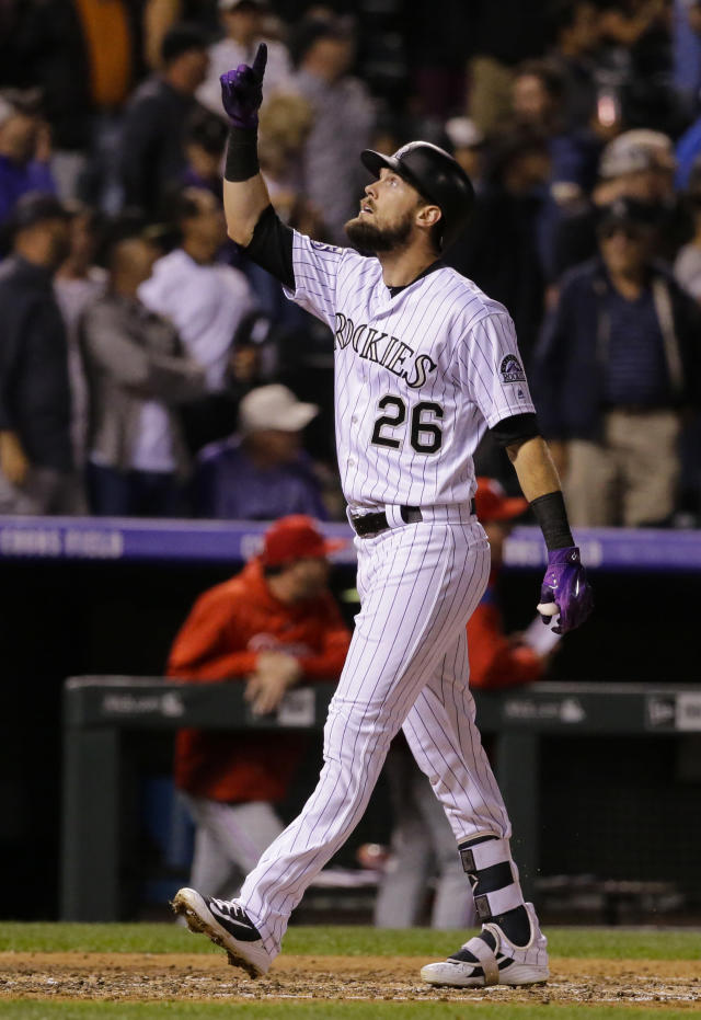 Colorado Rockies' David Dahl celebrates a solo home run against the Philadelphia Phillies during the fourth inning of a baseball game on Monday, Sept. 24, 2018, in Denver. (AP PhotoJack Dempsey)