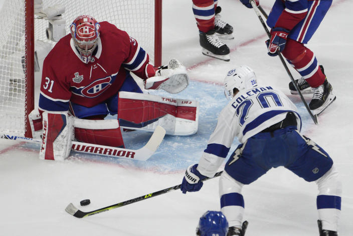 Montreal Canadiens goaltender Carey Price (31) makes a save against Tampa Bay Lightning center Blake Coleman (20) during the first period of Game 4 of the NHL hockey Stanley Cup final in Montreal, Monday, July 5, 2021. (Paul Chiasson/The Canadian Press via AP)