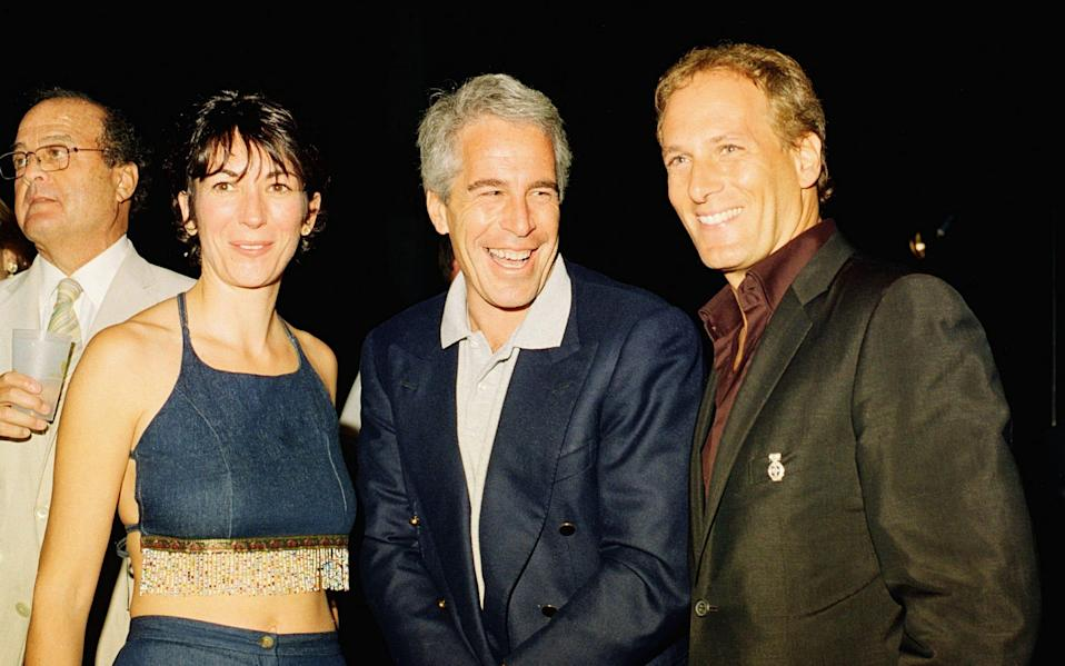 Ghislaine Maxwell, Jeffrey Epstein and musician Michael Bolton pose for a portrait during a party at the Mar-a-Lago club, Palm Beach, Florida, in 2000