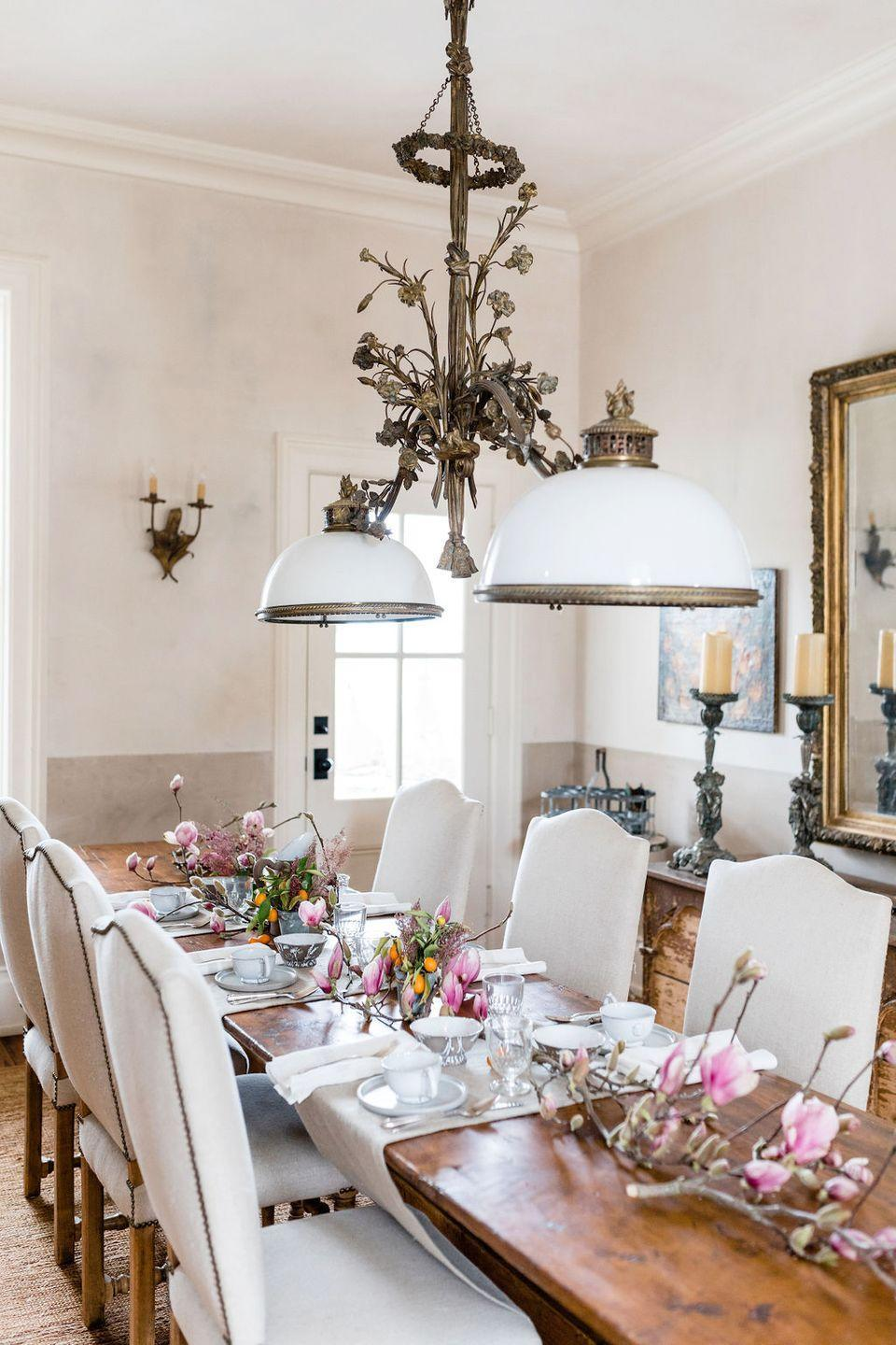"""<p>What could bring more springtime cheer than cherry blossoms? Lay some branches down the center of the table for a grounded, romantic Easter meal. </p><p><strong><em>West Elm SIN Venule Five-Way Vessel $268,</em></strong> <a class=""""link rapid-noclick-resp"""" href=""""https://go.redirectingat.com?id=74968X1596630&url=https%3A%2F%2Fwww.westelm.com%2Fproducts%2Flcl-sin-venule-five-way-vessel-d7297%2F&sref=https%3A%2F%2Fwww.housebeautiful.com%2Fentertaining%2Fflower-arrangements%2Fg19409803%2Feaster-flower-arrangements%2F"""" rel=""""nofollow noopener"""" target=""""_blank"""" data-ylk=""""slk:BUY NOW"""">BUY NOW</a></p>"""