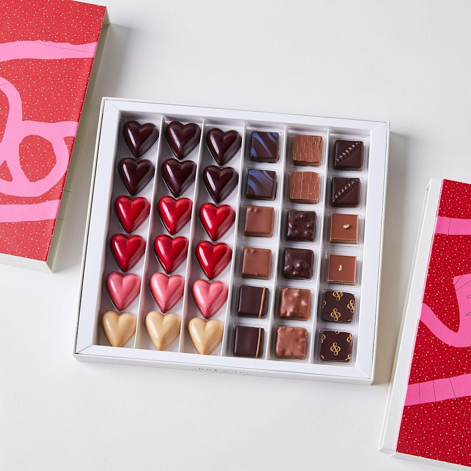 "<h2>andSons Chocolatiers Valentine's Day Gift Box</h2><br>This gift box is a romantic selection of the finest chocolates — truffles, caramels, and pralines with flavors including but not limited to Pecan Coffee, Madagascar Dark, and Hazelnut. Take a taste test this Valentine's Day and fall in love with a new flavor. <br><br><em>Shop</em> <strong><em><a href=""https://food52.com/shop/merchants/andsons"" rel=""nofollow noopener"" target=""_blank"" data-ylk=""slk:andSons"" class=""link rapid-noclick-resp"">andSons</a></em></strong><br><br><strong>andSons</strong> Chocolatiers Valentine's Day Gift Box, $, available at <a href=""https://go.skimresources.com/?id=30283X879131&url=https%3A%2F%2Ffood52.com%2Fshop%2Fproducts%2F8138-andsons-valentines"" rel=""nofollow noopener"" target=""_blank"" data-ylk=""slk:Food52"" class=""link rapid-noclick-resp"">Food52</a>"