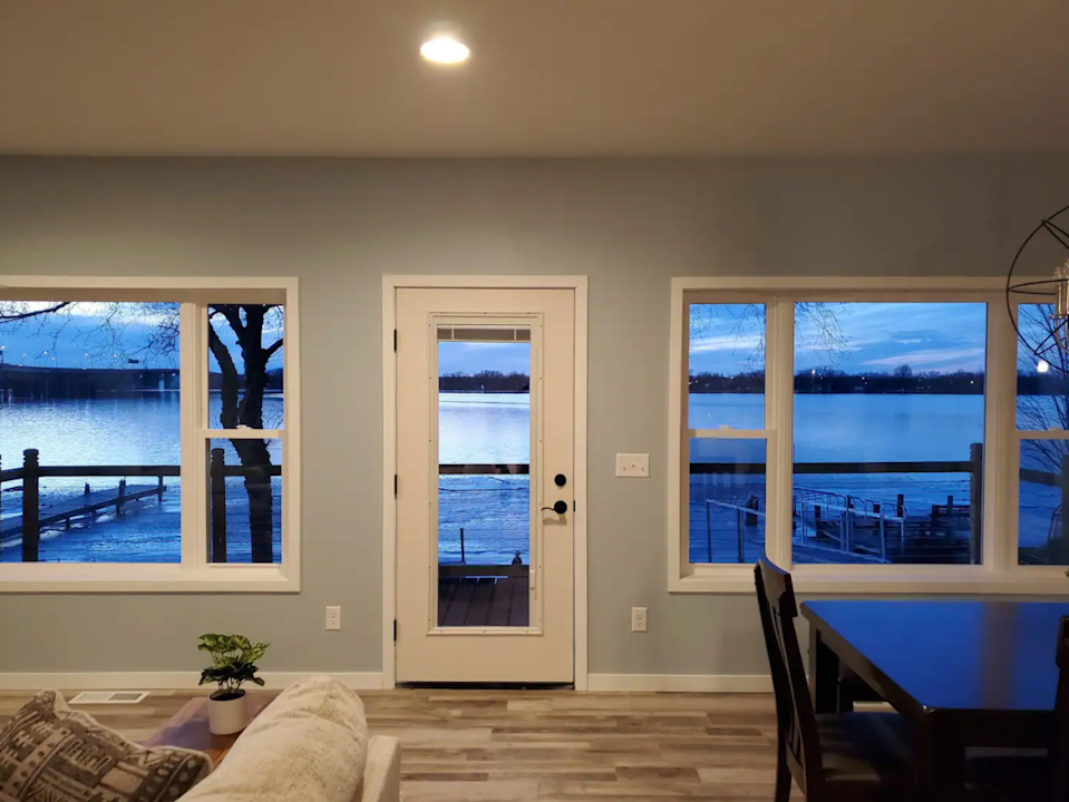 """<h2>Lake Winnebago, Wisconsin</h2><br><strong>Location</strong>: Menasha, Wisconsin<br><strong>Sleeps</strong>: 6<br><strong>Price Per Night</strong>: <a href=""""https://airbnb.pvxt.net/2raG27"""" rel=""""nofollow noopener"""" target=""""_blank"""" data-ylk=""""slk:$450"""" class=""""link rapid-noclick-resp"""">$450</a><br><br>""""Enjoy amazing sunsets, gorgeous water views, fast WiFi, bonfires, and many other amenities at this beautiful, modern lakehouse.<br><br>The location is great! Quiet and residential neighborhood only 10 away from downtown Appleton, Neenah, and Menasha.""""<br><h3><br>Book <a href=""""https://airbnb.pvxt.net/2raG27"""" rel=""""nofollow noopener"""" target=""""_blank"""" data-ylk=""""slk:Sunset Beach on Little Lake Butte Des Mortes"""" class=""""link rapid-noclick-resp"""">Sunset Beach on Little Lake Butte Des Mortes</a></h3>"""