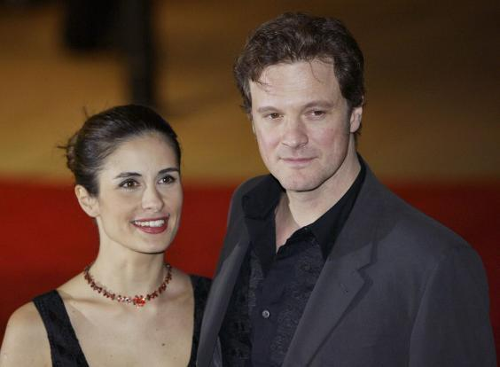"""Colin Firth and his wife Livia Giuggioli at the UK premiere of the film """"Love Actually"""" in 2003 (AFP via Getty Images)"""