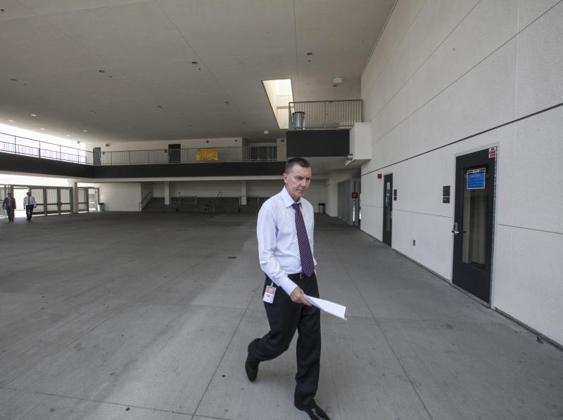 In this photo taken Thursday, June 14, 2012 Los Angeles Unified School District LAUSD Superintendent John Deasy tours the district in Los Angeles. Developing school leadership is a cornerstone of Deasy's strategy to reform Los Angeles Unified School District and sorting through principals underscores his philosophy that nothing in the sprawling district is too minute to warrant his attention. (AP Photo/Damian Dovarganes)