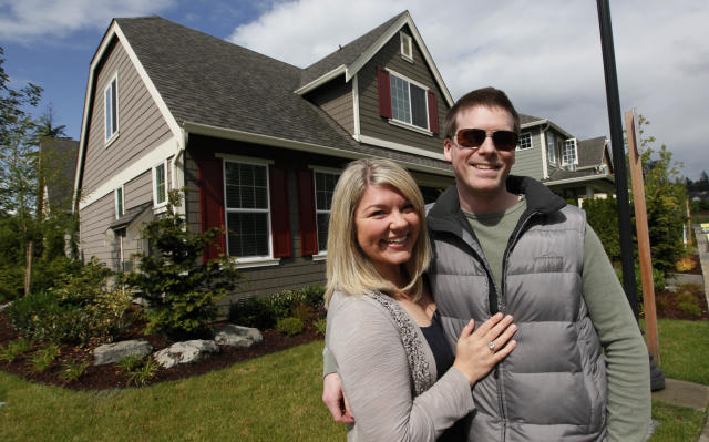 Laura Young, 28, and Andre Gjerde, 30, at their new home in Bothell, Washington (AP Photo/Elaine Thompson)