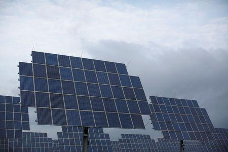 FILE PHOTO: Solar panels are seen under a cloudy sky in Bad Hersfeld May 14, 2013. REUTERS/Lisi Niesner/File Photo