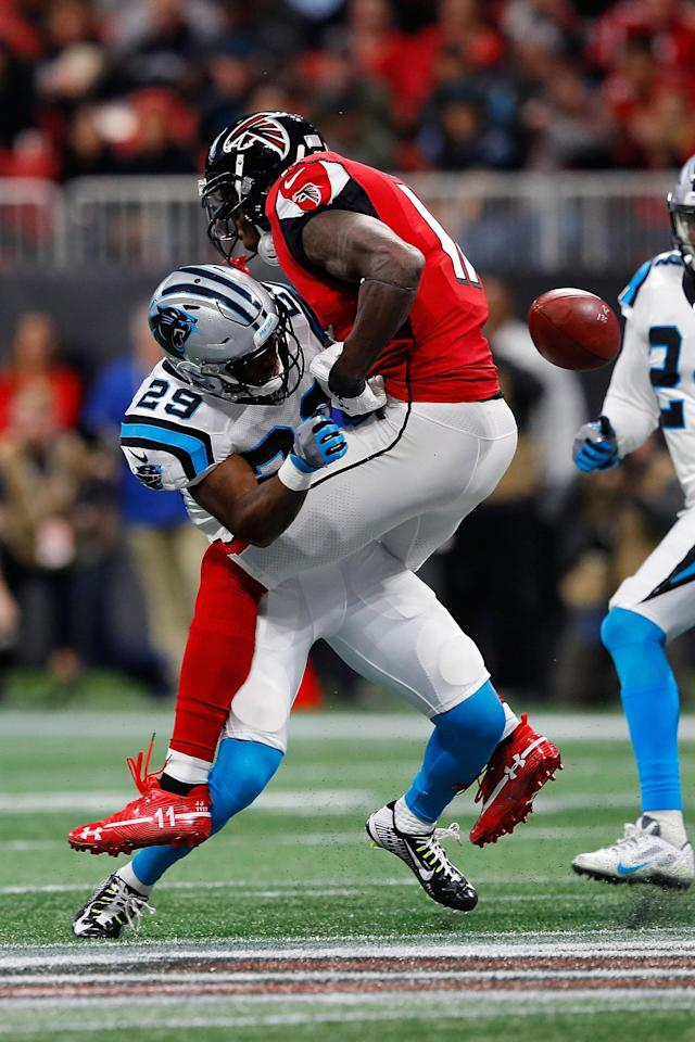 <p>Julio Jones #11 of the Atlanta Falcons fails to make a catch after being hit by Mike Adams #29 of the Carolina Panthers during the first half at Mercedes-Benz Stadium on December 31, 2017 in Atlanta, Georgia. (Photo by Kevin C. Cox/Getty Images) </p>
