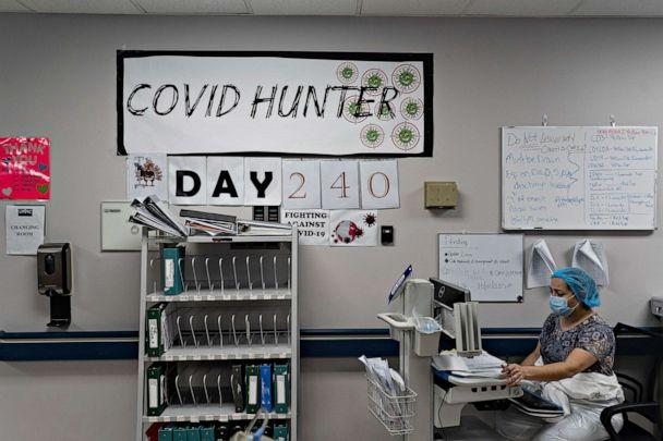 PHOTO: A medical staff member works on a computer as the number on the wall indicates the days since the hospital opened its COVID-19 unit at United Memorial Medical center on Nov. 14, 2020, in Houston. (Go Nakamura/Getty Images)