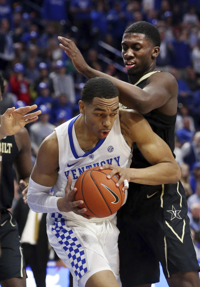 Kentucky's PJ Washington, bottom, looks for an opening on Vanderbilt's Aaron Nesmith during the first half of an NCAA college basketball game in Lexington, Ky., Saturday, Jan. 12, 2019. (AP Photo/James Crisp)