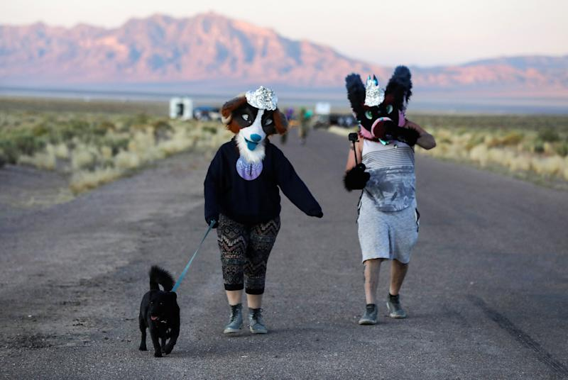 People dressed in costumes walk to an entrance to Area 51 as an influx of tourists responding to a call to 'storm' Area 51, a secretive U.S. military base believed by UFO enthusiasts to hold government secrets about extra-terrestrials, is expected in Rachel, Nevada, U.S. September 20, 2019. REUTERS/Jim Urquhart