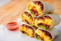 """<p>A breakfast burrito is easy to make and often a fan favorite. Serve with a side of salsa or some hot sauce so your mom can kick it up a notch. </p><p><strong><em>Get the recipe at <a href=""""https://www.delish.com/cooking/recipe-ideas/a24569400/breakfast-burrito-recipe/"""" rel=""""nofollow noopener"""" target=""""_blank"""" data-ylk=""""slk:Delish"""" class=""""link rapid-noclick-resp"""">Delish</a>. </em></strong></p>"""