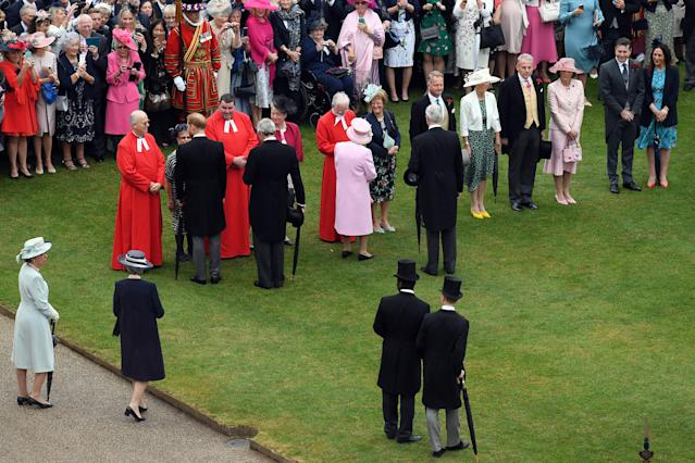 The Queen greets some of the 8,000 guests at the party. (Getty Images)