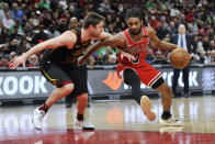 Chicago Bulls' Coby White (0) drives against Cleveland Cavaliers' Cedi Osman (16) during the second half of an NBA basketball game Tuesday, March 10, 2020, in Chicago. (AP Photo/Paul Beaty)