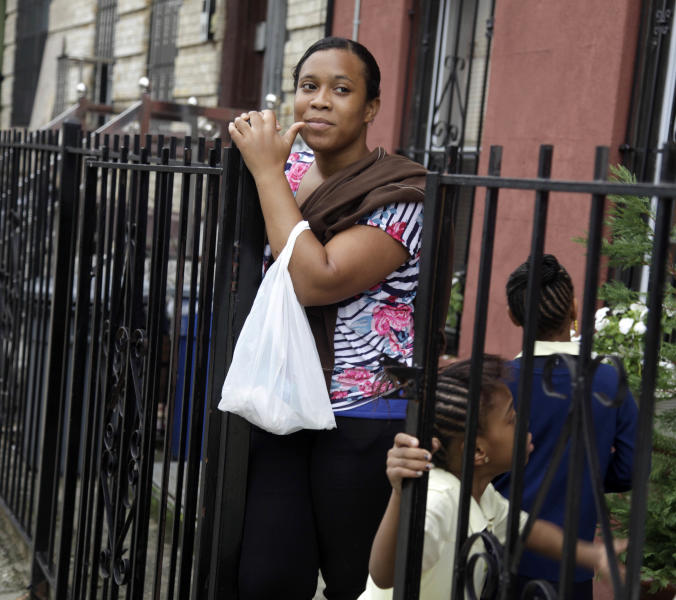 Olgita Blackwood waits for her son to return home from school at her apartment in the Drew House in New York, Wednesday, Oct. 3, 2012. The program, called Drew House, is one of a kind in the nation, where mothers arrested on felonies can live with their children, instead of in prison. The program has been lauded as a success that should be replicated around the country, but the small house is already full, and without additional funding and space, it can't grow. (AP Photo/Seth Wenig)
