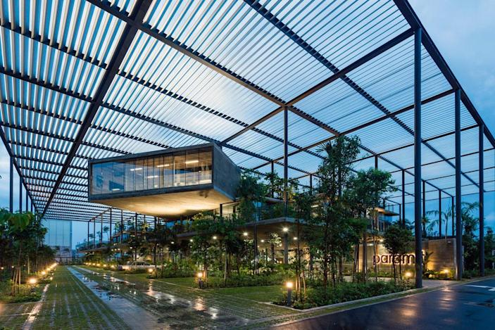 Rooftop canopy keeps the factory spaces within nice and shady without sacrificing any ventilation.