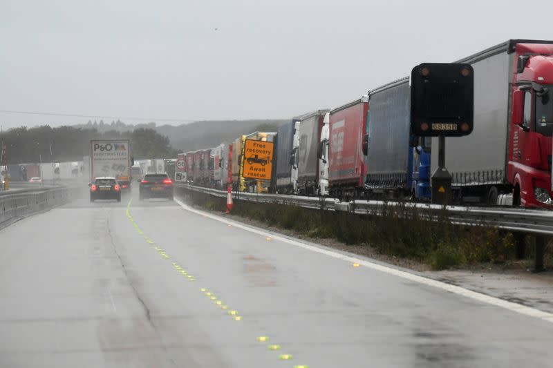 FILE PHOTO: Lorries are seen parked on the southbound M20 motorway, as part of Operation Stack, as they wait to be allowed to proceed to the Port of Dover