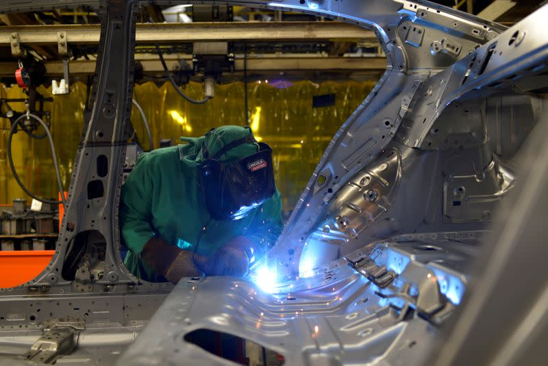 FILE PHOTO: Line workers spot weld parts of the frame on the flex line at Nissan Motor Co's automobile manufacturing plant in Smyrna Tennessee
