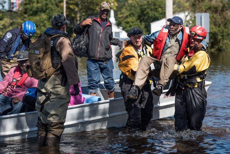 A rescue team transports residents to dry land on October 12, 2016 in Lumberton, N.C. (Photo: Sean Rayford/Getty Images)