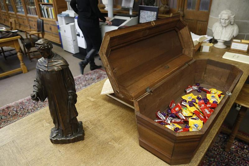 """This Oct. 29, 2013, photo taken in Evanston, Ill., shows an actual child's coffin filled with candy at the McCormick Library of Special Collections. The coffin is one of the artifacts from the """"Death Collection"""" - an archive of death-related oddities once owned by horror novelist and screenwriter Michael McEachern McDowell that were purchased by Northwestern University. (AP Photo/M. Spencer Green)"""