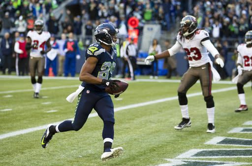 Seattle Seahawks' wide receiver Doug Baldwin runs into the end zone to score a touchdown on a reception in the second half of an NFL football game against the Tampa Bay Buccaneers, Sunday, Nov. 3, 2013, in Seattle. (AP Photo/Stephen Brashear)