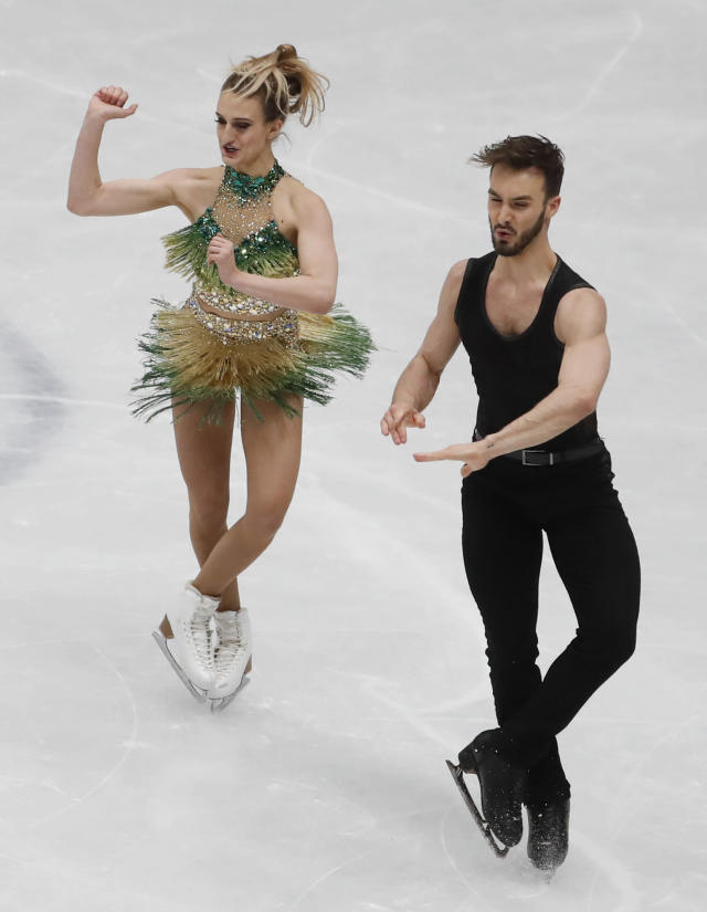 Gabriella Papadakis and Guillaume Cizeron of France perform during the pairs Ice dance short program at the Figure Skating World Championships in Assago, near Milan, Friday, March 23, 2018. (AP Photo/Antonio Calanni)