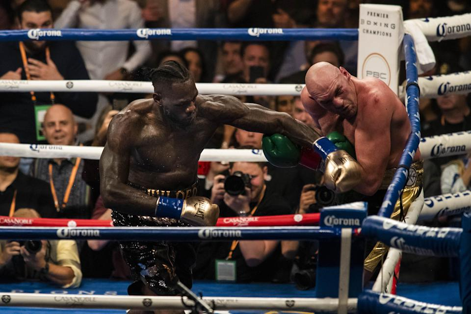 Deontay Wilder lands a left hand against Tyson Fury in the 12th round of their heavyweight championship fight at the Staples Center in Los Angeles on Saturday. (Getty Images)