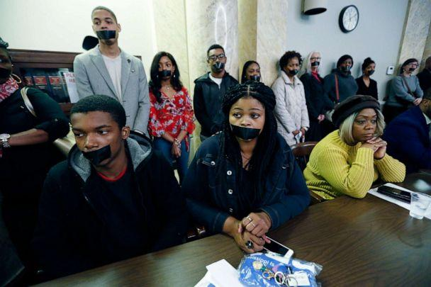 PHOTO: Prison reform advocates wear strips of tape across their mouths as a silent protest during a hearing of the House Corrections and Judiciary B Committees to address current corrections issues, Feb. 13, 2020, at the Capitol in Jackson, Miss. (Rogelio V. Solis/AP, FILE)