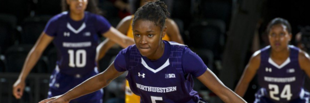 557147d40 Jordan Hankins in her purple Northwestern basketball gear on the court. Her  arms are spread