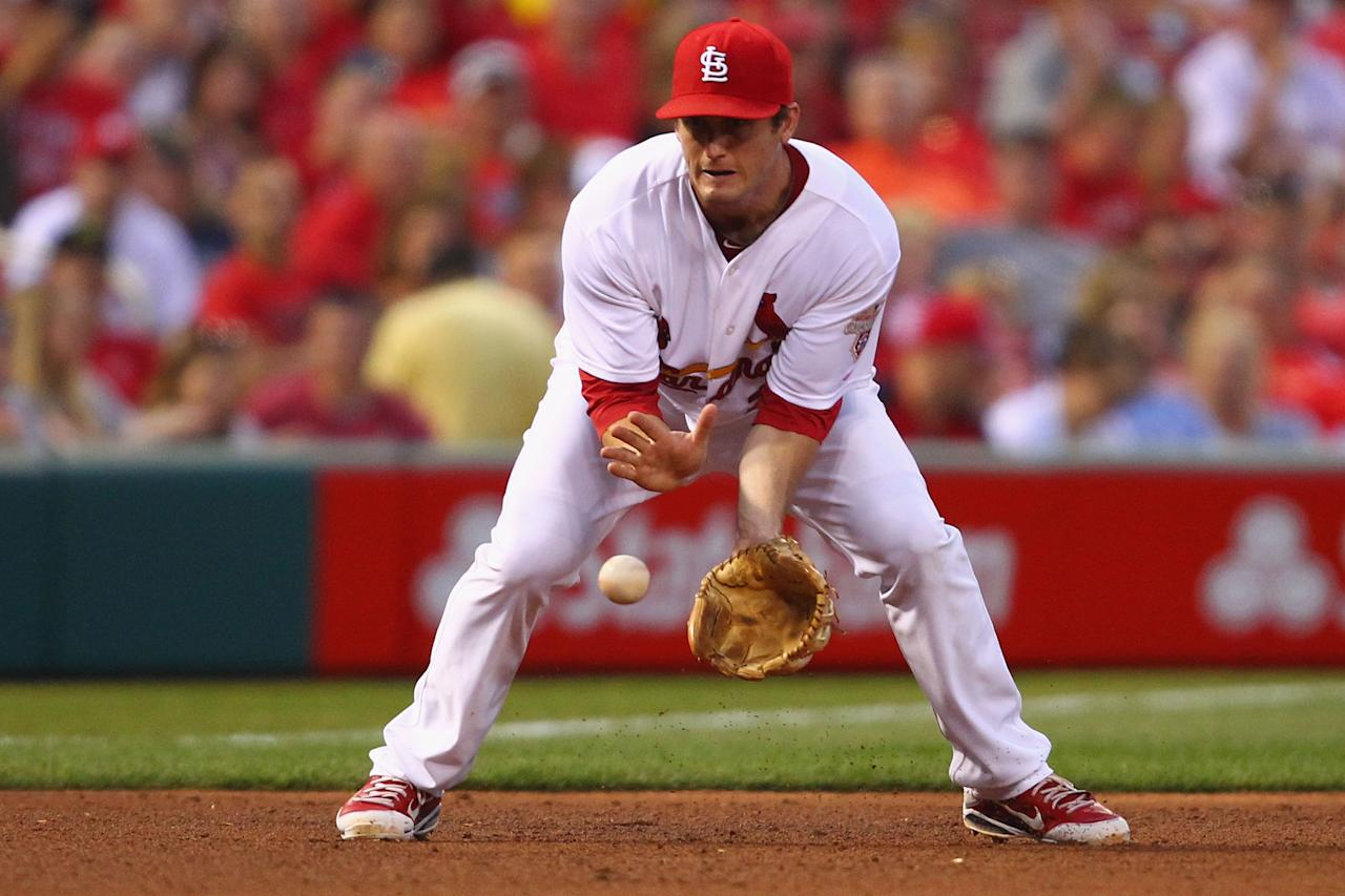 ST. LOUIS, MO - MAY 25: David Freese #23 of the St. Louis Cardinals fields a one hopper against the Philadelphia Phillies at Busch Stadium on May 25, 2012 in St. Louis, Missouri.  (Photo by Dilip Vishwanat/Getty Images)