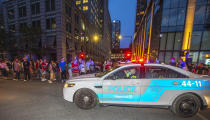 A police cruiser patrols around the Bell Centre, where thousands of Montreal Canadiens fans have assembled for Game 6 of an NHL hockey Stanley Cup semifinal playoff series against the Vegas Golden Knights, in Montreal, Thursday, June 24, 2021. Today is also the provincial holiday of Saint-Jean-Baptiste Day. T(Peter McCabe/The Canadian Press via AP)