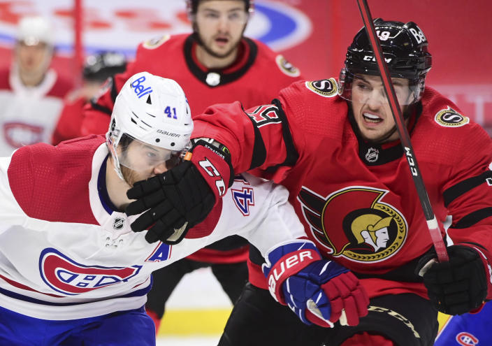 Ottawa Senators right wing Drake Batherson (19) gives Montreal Canadiens left wing Paul Byron (41) a facewash during the first period of an NHL hockey game in Ottawa on Saturday, Feb. 6, 2021. (Sean Kilpatrick/The Canadian Press via AP)