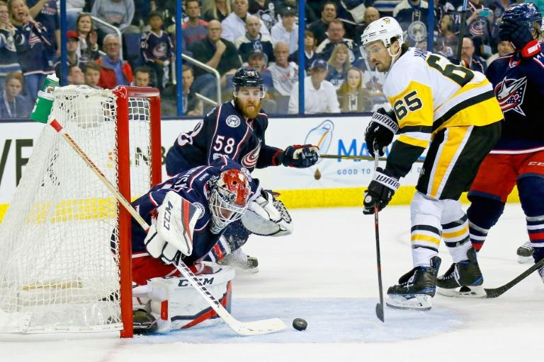 The Columbus Blue Jackets' goalie Sergei Bobrovsky stops a shot from Ron Hainsey of the Pittsburgh Penguins in Game Four of the Eastern Conference first round playoffs, at Nationwide Arena in Columbus, Ohio, on April 18, 2017