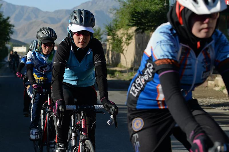 Members of the Afghan national women's cycling team riding their road bikes in Paghman district of Kabul province, June 9, 2014 (AFP Photo/Shah Marai)