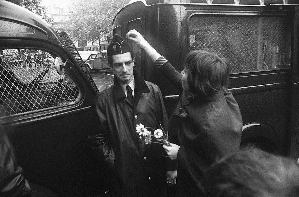 <p>A pacifist student puts a flower in the cap of a wary police officer guarding the Sorbonne during the student riots, Boulevard Saint-Michel, Paris, June 16, 1968. The protests of May 1968 also gave impetus to the women's liberation movement in France and the recognition of homosexuality. (Photograph by Gökşin Sipahioğlu/SIPA) </p>