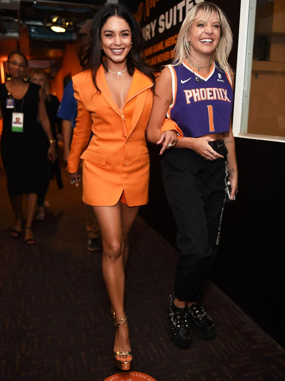 <p>Vanessa Hudgens is all smiles after performing the National Anthem for the Milwaukee Bucks vs. Phoenix Suns game in Arizona.</p>