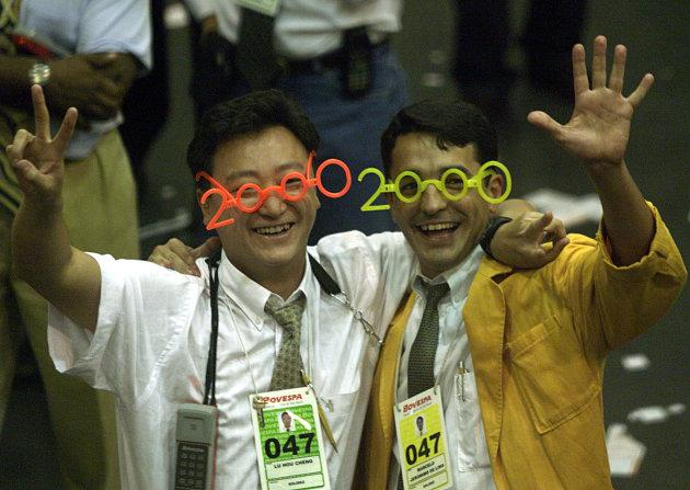 Stock traders wearing Y2K glasses celebrate at the last trading day 1999, where closed up with the historic record of 17,091 points, in the floor of Sao Paulo's Stock Exchange on Dec. 30, 1999.