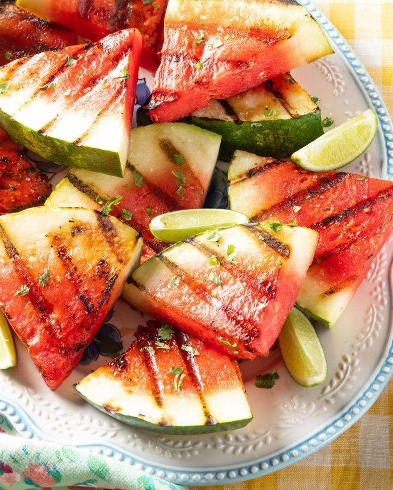"""<p>You'll see your favorite summer fruit in a whole new light after it's charred on the grill and seasoned with lime, salt, and sugar. </p><p><strong><a href=""""https://www.thepioneerwoman.com/food-cooking/recipes/a35936464/grilled-watermelon/"""" rel=""""nofollow noopener"""" target=""""_blank"""" data-ylk=""""slk:Get the recipe"""" class=""""link rapid-noclick-resp"""">Get the recipe</a>.</strong></p><p><a class=""""link rapid-noclick-resp"""" href=""""https://go.redirectingat.com?id=74968X1596630&url=https%3A%2F%2Fwww.walmart.com%2Fbrowse%2Fhome%2Fserveware%2Fthe-pioneer-woman%2F4044_623679_639999_2347672&sref=https%3A%2F%2Fwww.thepioneerwoman.com%2Ffood-cooking%2Fmeals-menus%2Fg32188535%2Fbest-grilling-recipes%2F"""" rel=""""nofollow noopener"""" target=""""_blank"""" data-ylk=""""slk:SHOP PLATTERS"""">SHOP PLATTERS</a></p>"""
