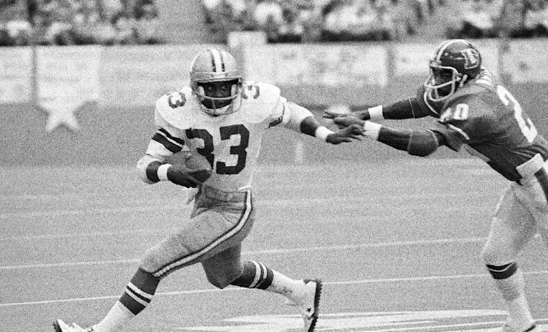 "FILE - In this Dec. 18, 1977 file photo, Dallas Cowboys' Tony Dorsett (33) tries top get past Denver Broncos safety Billy Thompson, in the first quarter of an NFL football game in Irving, Texas. Bad as the expansion Tampa Bay Buccaneers were in 1976, going 0-14 on the way to what became a 26-game losing streak, they never were as big of an underdog as the Jacksonville Jaguars are against the Denver Broncos this weekend. Looking at ""consensus"" lines _ the market average from multiple odds-makers _ there have been eight previous NFL games since 1972 in which one team was at least a three-touchdown favorite, according to RJ Bell, who runs a website that analyzes betting and betting patterns. (AP Photo/File)"