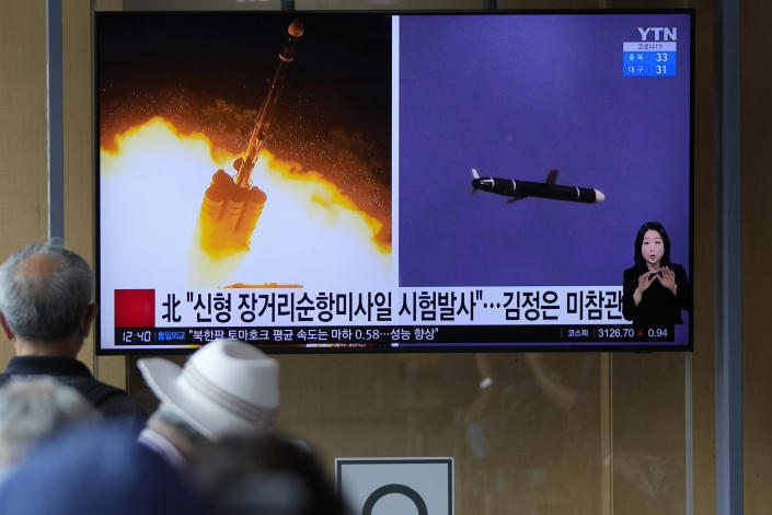 """People watch a TV screen showing a news program reporting about North Korea's long-range cruise missiles tests with images in Seoul, South Korea, Monday, Sept. 13, 2021. North Korea says it successfully test fired newly developed long-range cruise missiles over the weekend, its first known testing activity in months, underscoring how it continues to expand its military capabilities amid a stalemate in nuclear negotiations with the United States. The letters read, """"The North newly test-fired long-range cruise missiles."""" (AP Photo/Lee Jin-man)"""