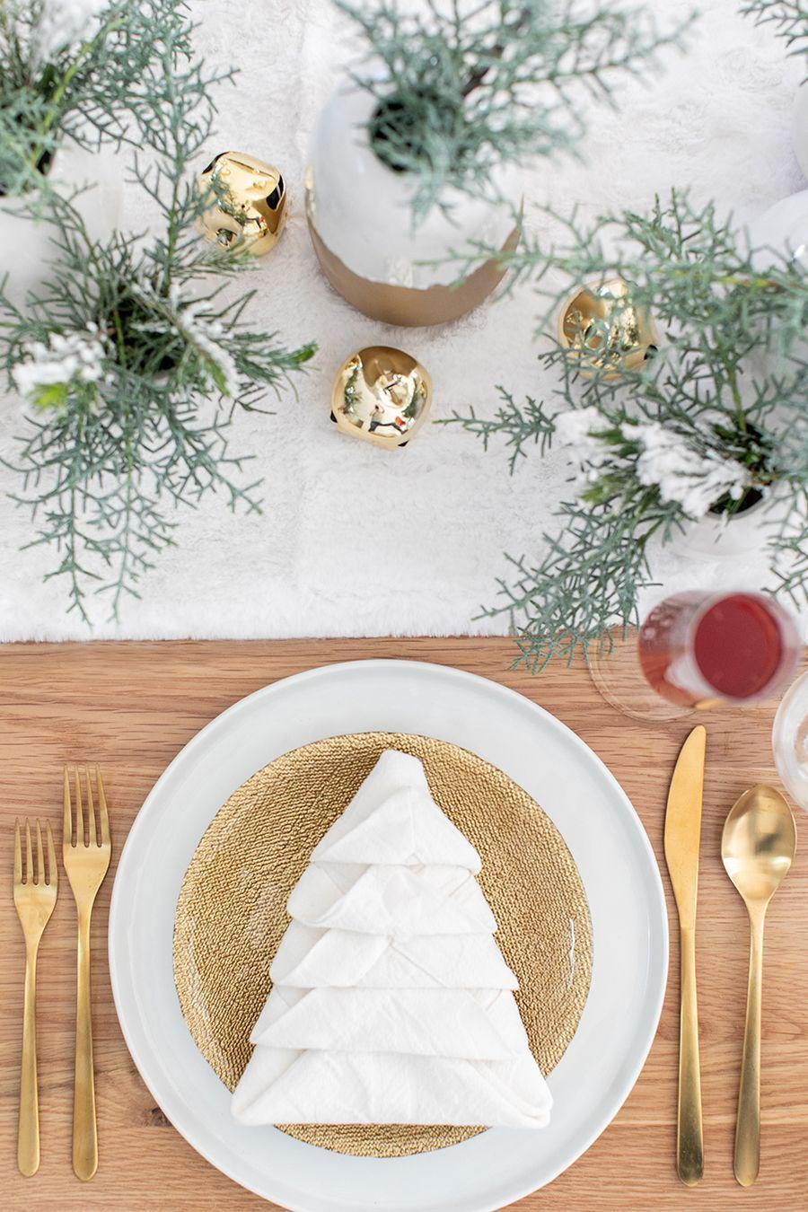"<p>Wow your guests with this stunning Christmas tree napkin! Believe it or not, it's super easy to pull off—you just need a few large linen napkins to get started.</p><p><strong>Get the tutorial at <a href=""https://sugarandcharm.com/how-to-put-together-a-charming-christmas-brunch"" rel=""nofollow noopener"" target=""_blank"" data-ylk=""slk:Sugar and Charm"" class=""link rapid-noclick-resp"">Sugar and Charm</a>.</strong></p><p><strong><a class=""link rapid-noclick-resp"" href=""https://www.amazon.com/Berglander-Flatware-Stainless-Titanium-Silverware/dp/B07536QR2Y?tag=syn-yahoo-20&ascsubtag=%5Bartid%7C10050.g.644%5Bsrc%7Cyahoo-us"" rel=""nofollow noopener"" target=""_blank"" data-ylk=""slk:SHOP GOLD FLATWARE"">SHOP GOLD FLATWARE</a></strong></p>"