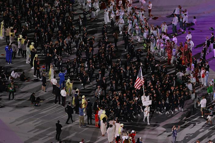 <p>TOKYO, JAPAN - JULY 23: Flag bearers Sue Bird and Eddy Alvares of Team United States lead their team during the Opening Ceremony of the Tokyo 2020 Olympic Games at Olympic Stadium on July 23, 2021 in Tokyo, Japan. (Photo by Richard Heathcote/Getty Images)</p>