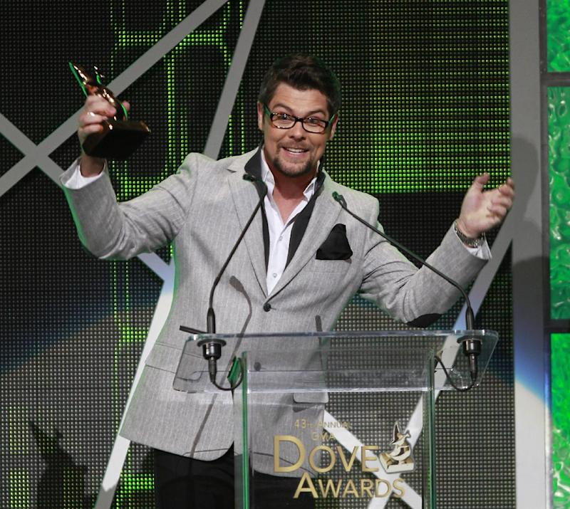 Gospel singer Jason Crabb reacts after winning the Dove Award for male artist of the year during taping of the Gospel Music Association Dove Awards at Atlanta's Fox Theater Thursday, April 19, 2012. (AP Photo/John Bazemore)