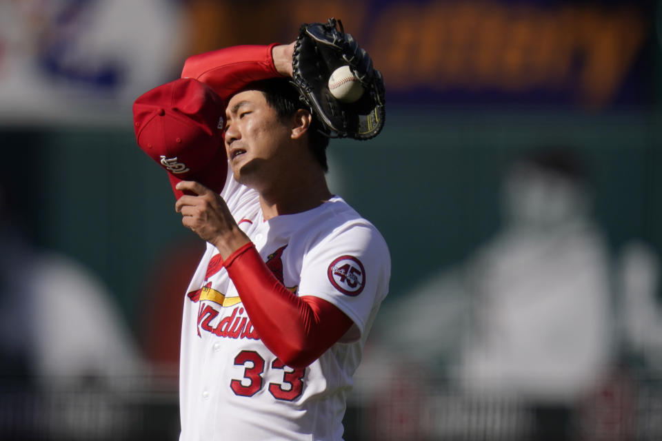 St. Louis Cardinals starting pitcher Kwang Hyun Kim pauses on the mound during the third inning in the first game of a baseball doubleheader against the New York Mets Wednesday, May 5, 2021, in St. Louis. (AP Photo/Jeff Roberson)