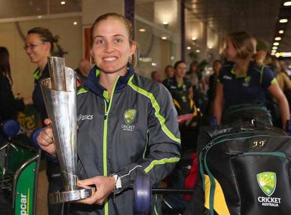 MELBOURNE, AUSTRALIA - OCTOBER 09:  Jodie Fields of the Southern Stars poses with the trophy after arriving back home to Australia after winning the 2012 ICC Women's T20 World Cup, at Melbourne International Airport on October 9, 2012 in Melbourne, Australia.  (Photo by Quinn Rooney/Getty Images)