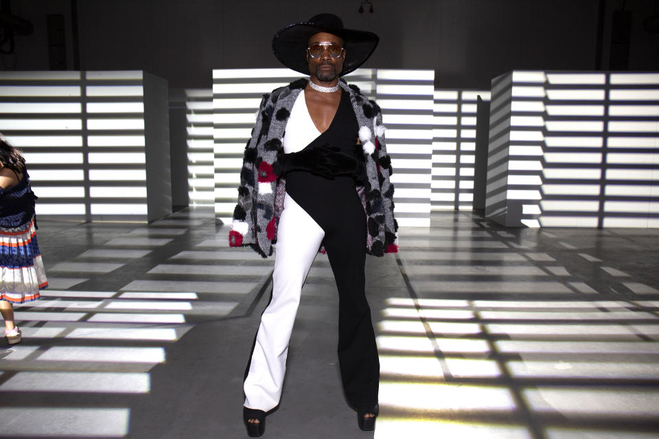 Billy Porter arrives at the PREEN by Thornton Bregazzi wearing a black and white monochrome jumpsuit and black cowboy hat [Photo: Getty Images]