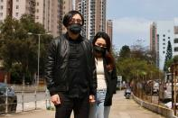 Pro-democracy activist Mike Lam King-nam arrives with his wife to report to the police station over national security law charges