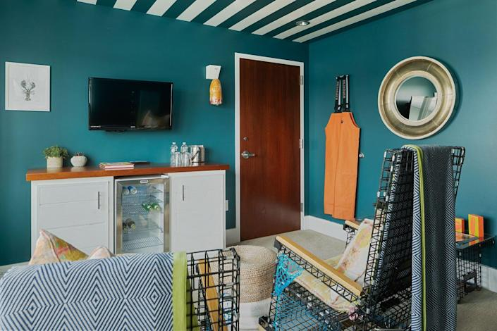 lobster-themed hotel suite with lobster trap rocking chair