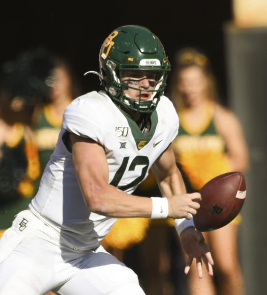 Baylor quarterback Charlie Brewer (12) fumbles the football during the first half of an NCAA college football game against Oklahoma State in Stillwater, Okla., Saturday, Oct. 19, 2019. (AP Photo/Brody Schmidt)