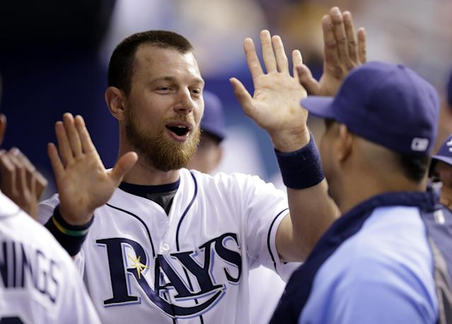 Tampa Bay Rays' Ben Zobrist high fives teammates after scoring on an RBI single by Matt Joyce off Los Angeles Angels relief pitcher Jarrett Grube during the eighth inning of a baseball game Saturday, Aug. 2, 2014, in St. Petersburg, Fla. (AP Photo/Chris O'Meara)